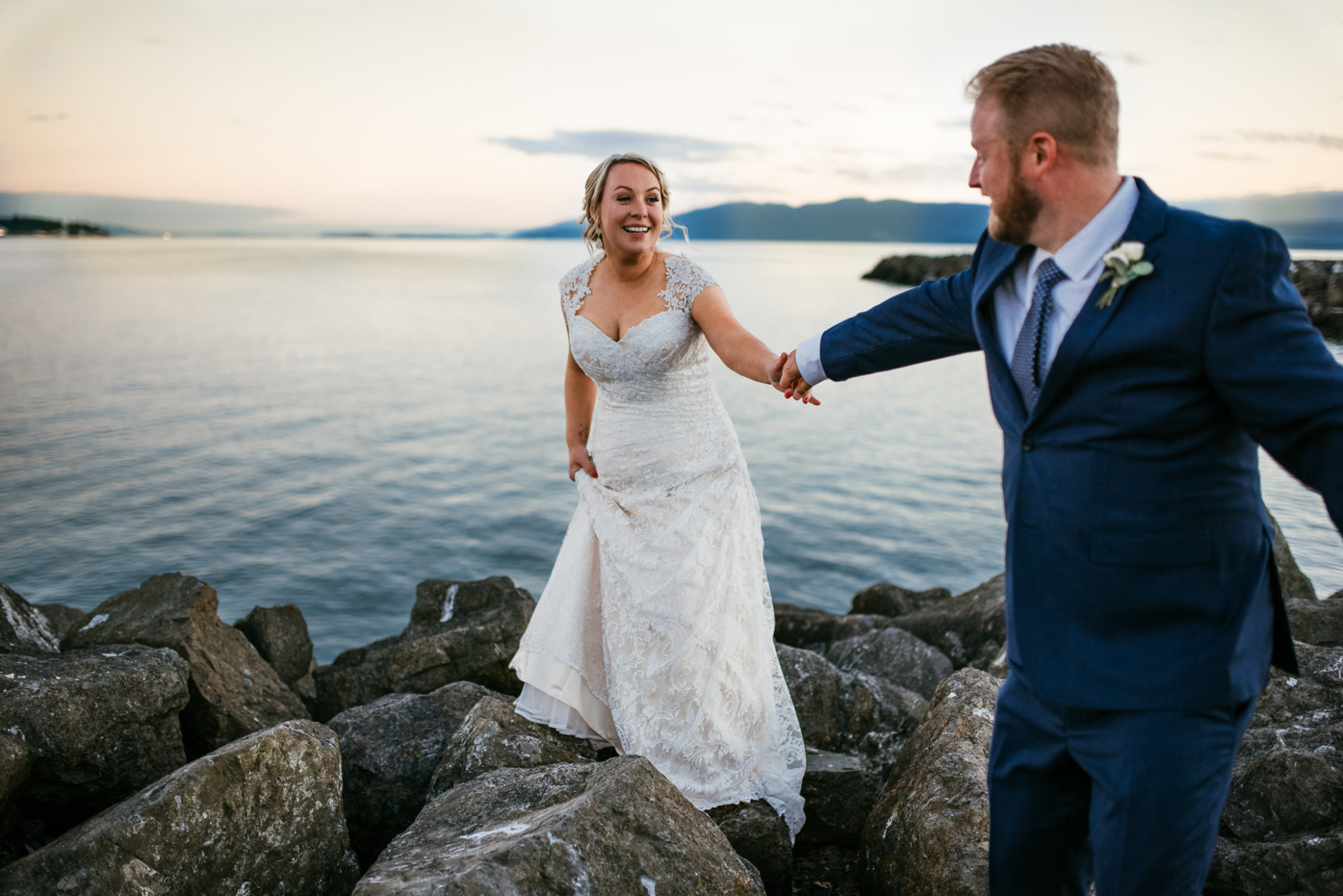 Bride and groom share intimate moment near the water by Jessica Uhler Photography